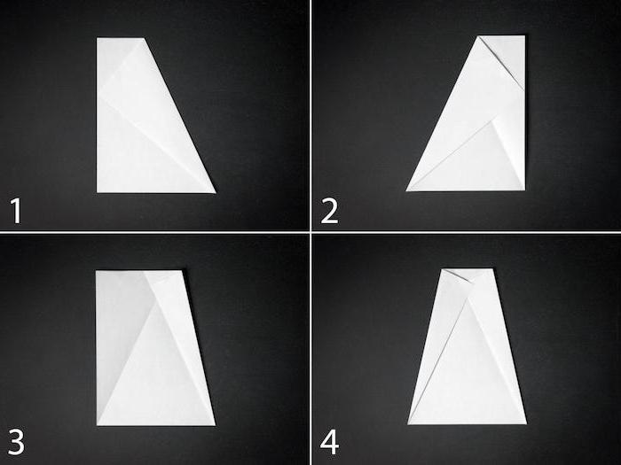 ein schwarzer tisch, eine diy papierflieger anleitung in vier schritten, einen weißen papierflieger aus papier selber basteln