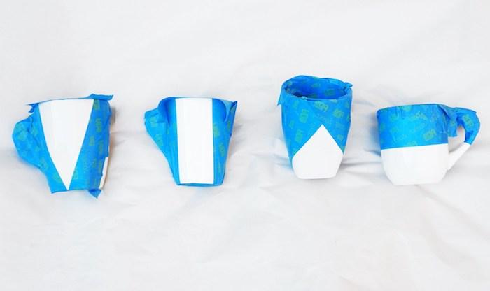 Weiße Porzellantassen mit goldenem Spray besprühen, Schritt Eins, die Tassen mit Klebeband bekleben
