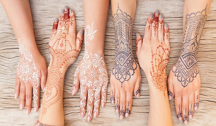 weißes henna, mehndi in verscheidenen farben, arme mit henna verzieren, temporäre tattoos