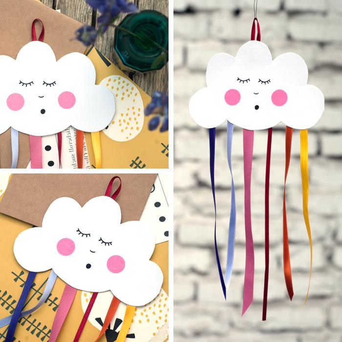 Deko für Babyzimmer selber basteln, Wolke aus Papier schneiden, bunte Streifen für Regenbogen