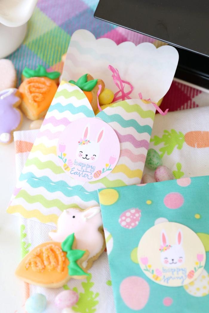 basteln ostern, geschenktüten aus buntem papier, tüten mit süßigkeiten, sticker mit hasen
