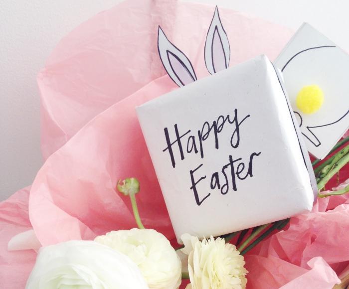 basteln ostern, weißes box aus cardstock dekoriert mit schwarzem marker, hasenohren aus papier