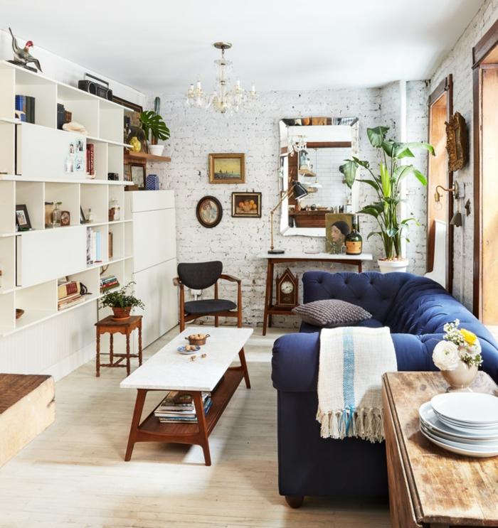 Backstein Optik weiße Wand, Regalsystem in weißer Farbe, Laminat Boden, kleine Räume einrichten