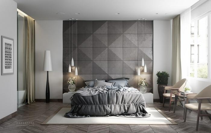 graues Schlafzimmer einrichten, hängende Lampen, zwei Stühle und ein Tisch, graue Bettwäsche