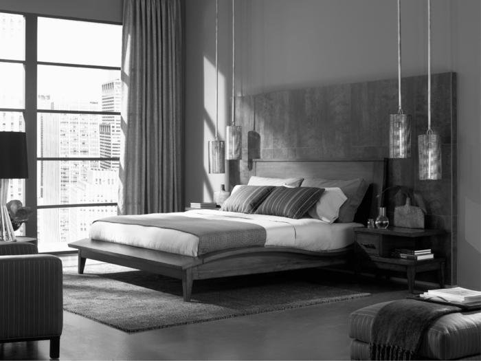 vier hängende Lampen, viel natürliches Licht, ein grauer Teppich, Schlafzimmer einrichten
