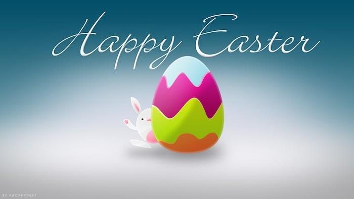 ein großes gefärbtes buntes ei, ostergrüße lustig, ein kleiner weißer osterhase mit schwarzen auhen und zwei pinken hasenohren