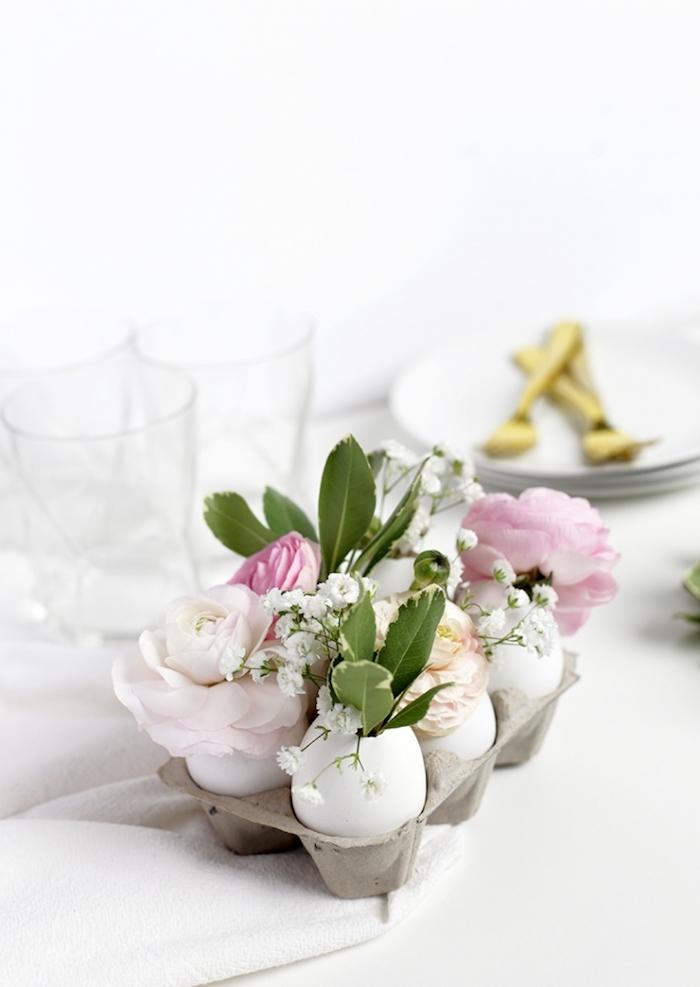Kreative DIY Idee für Tischdeko, Eier als Vasen voll mit echten Blüten und Blättern