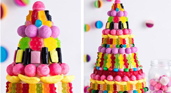 große gummibärchen torte zum geburtstag, torte dekoriert mit bunten verschiedenartigen geleebonbons