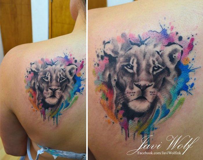 löwe bedeutung, frau mit wasserfarben tattoo am rücken, tattoos für frauen