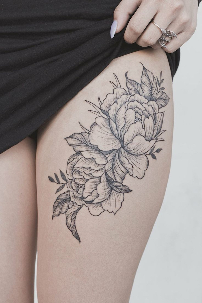 Frauen oberschenkel tattoo Oberschenkel Tattoos