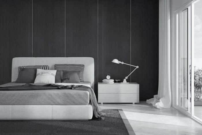 ein graues Bett, welche Farbe passt zu Grau, weißes Kissen und weißer Nachttisch