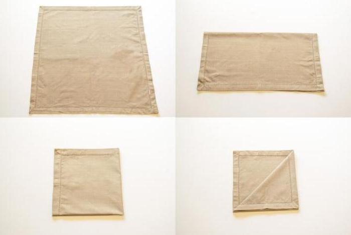 eine diy anleitung in vier schritten, eine kleine beige gefaltete serviette, eine besteckttasche falten