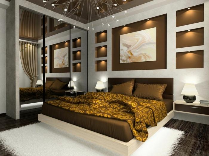 luxuseinrichtung zu hause, schlafzimmer bett in golden und braun, weiß, lichtkette, lüster