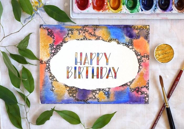 geburtstgskarten selber machen, klappkarte aus aquarellpapier bemalt mit wasserfarben, pinsel, grüne blätter
