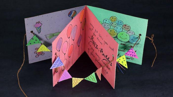pop up karte basteln, geburtstagskarte aus buntem papier, luftballons zeichnen, girlande aus dreiecken und garn