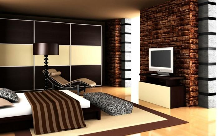 natürliche schlafzimmer farben, braun, beige, weiß, fernsehwand. steinwand im schlafzimmer. liegesessel