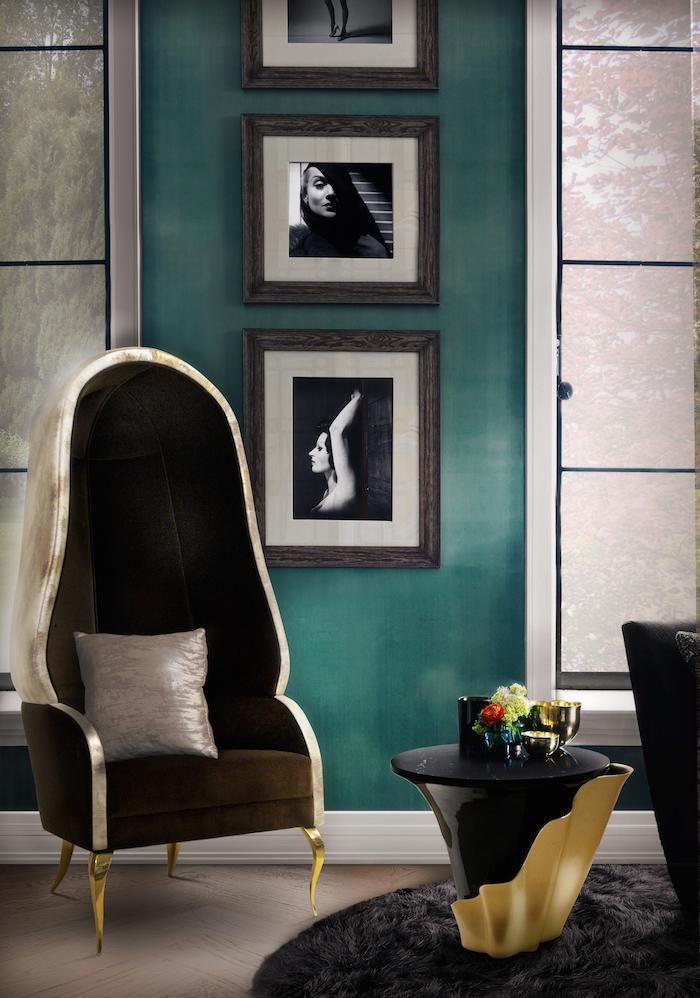 Wohnzimmer Einrichtungsideen, Wandfarbe Petrol, drei Bilder in Rahmen, schwarze Möbel