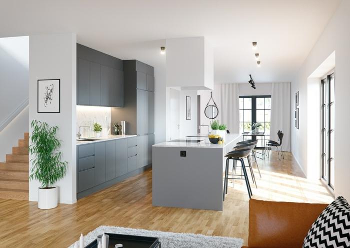 eine Einzimmerwohnung, eingebaute Küche, ein runder Spiegel, Wandfarbe Hellgrau