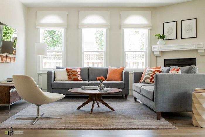graue wandfarbe mit vorhängen dekorieren, zwei doppelsofas, sessel, runder kaffeetisch
