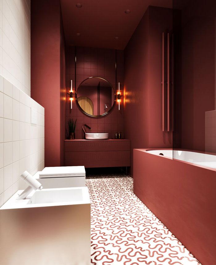 Badezimmer Einrichtung, rote Wandfliesen und Badewanne, weißes Waschbecken, runder Spiegel