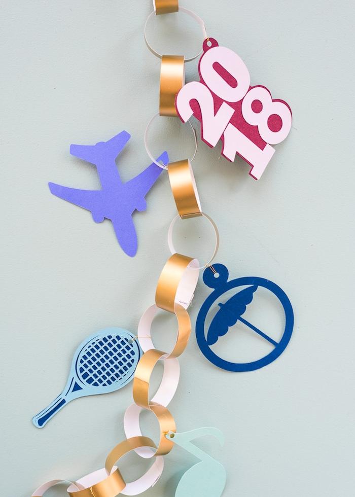 Girlande aus Papier selbstgemacht, lustige Figuren ausschneiden, DIY Idee für Kinder