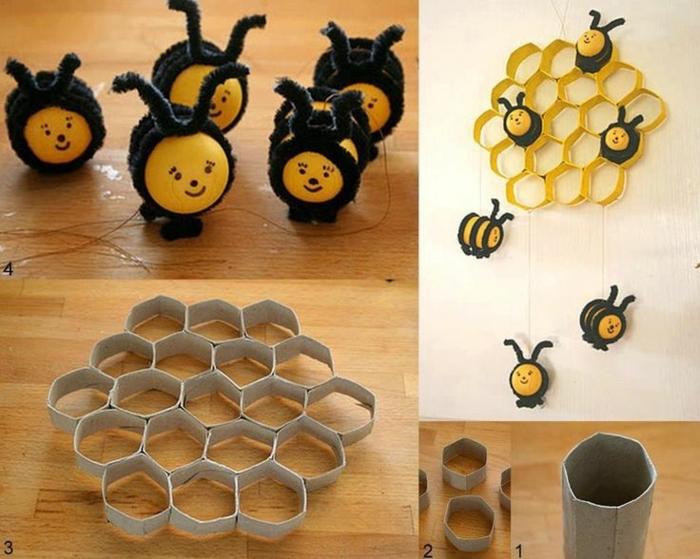 ein Bienenkorb aus Klorollen basteln viele kleine Biene aus Überraschungseier