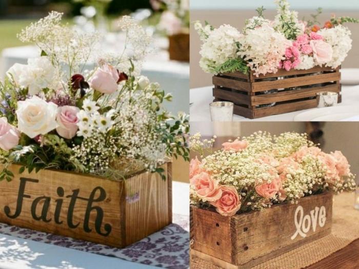 blumendeko tisch mit dekorationen und aufschriften auf den kasten, blumentöpfen