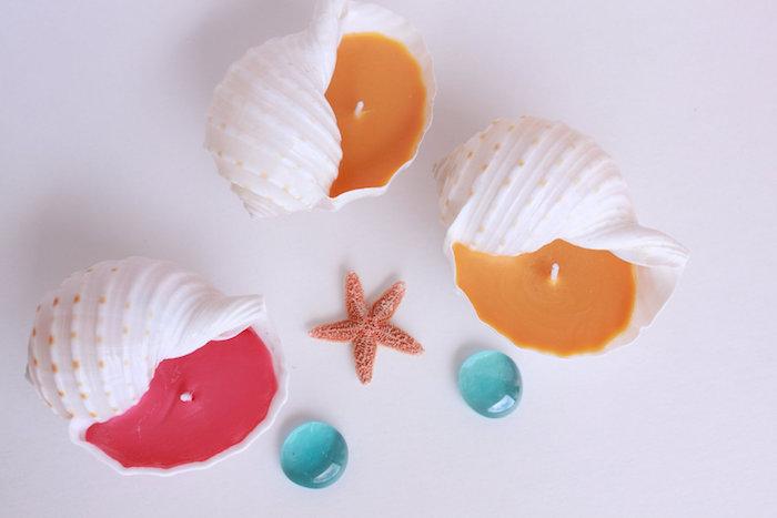 Kerzenhalter aus Trompetenmuscheln selber machen, Paraffin Wachs in Rot und Orange