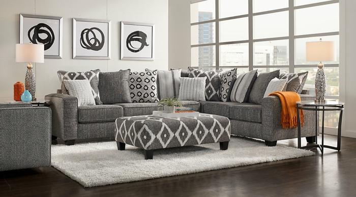 graues Sofa, weißer Teppich, drei weiße Bilder mit schwarzen Kreisen, moderne Wohnzimmer