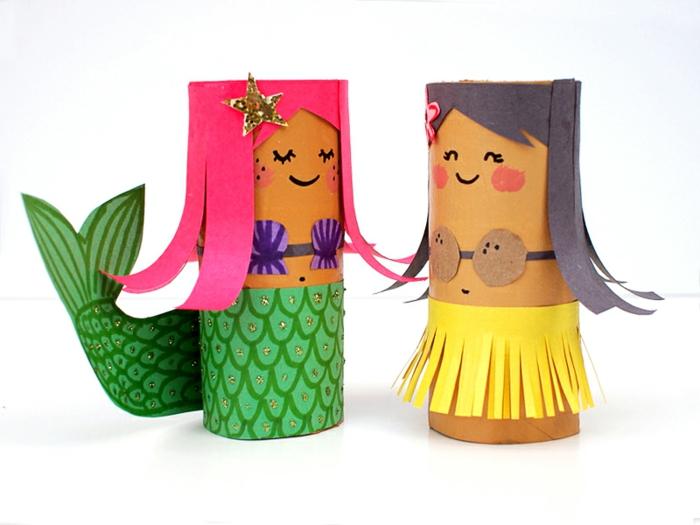 mit buntem Papier als Dekoration und Basteln aus Klopapierrollen, zwei Mädchen