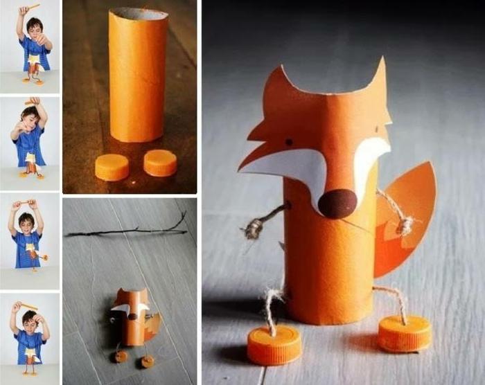 Eine Stringpuppe Fuchs, das Kind spielt damit Basteln aus Toilettenpapierrollen und Deckeln