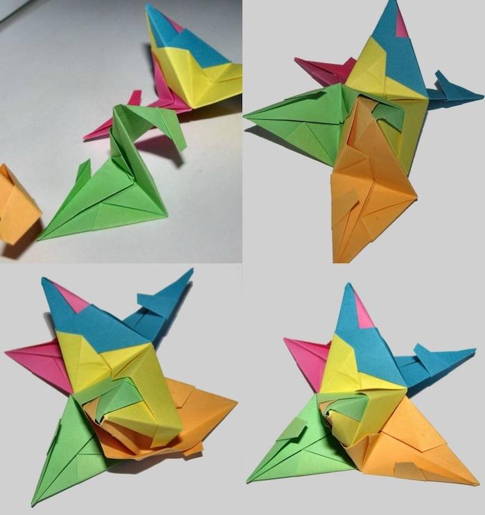 ein weißer tisch und origami formen aus orangen, blauen, violetten und gelben papierblättern, eine bascetta stern anleitung