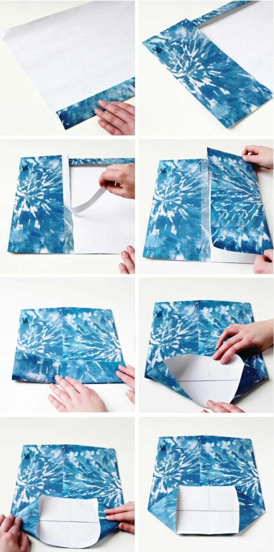 Schritt für Schritt Faltanleitung von blauen Papier mit abstrakten Motiven, Geschenktüten basteln