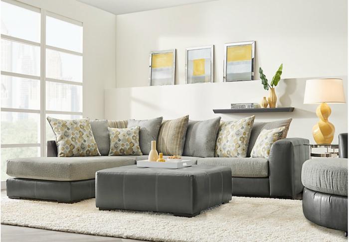schöne Wohnzimmer, ein graues Wohnzimmer mit braunen Kissen und weißer Teppich