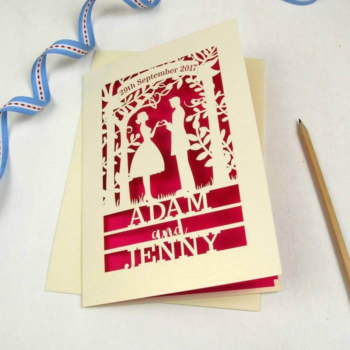 Kreative Idee für selbstgemachte Hochzeitskarte, Figuren und Aufschrift auf rotem Grund