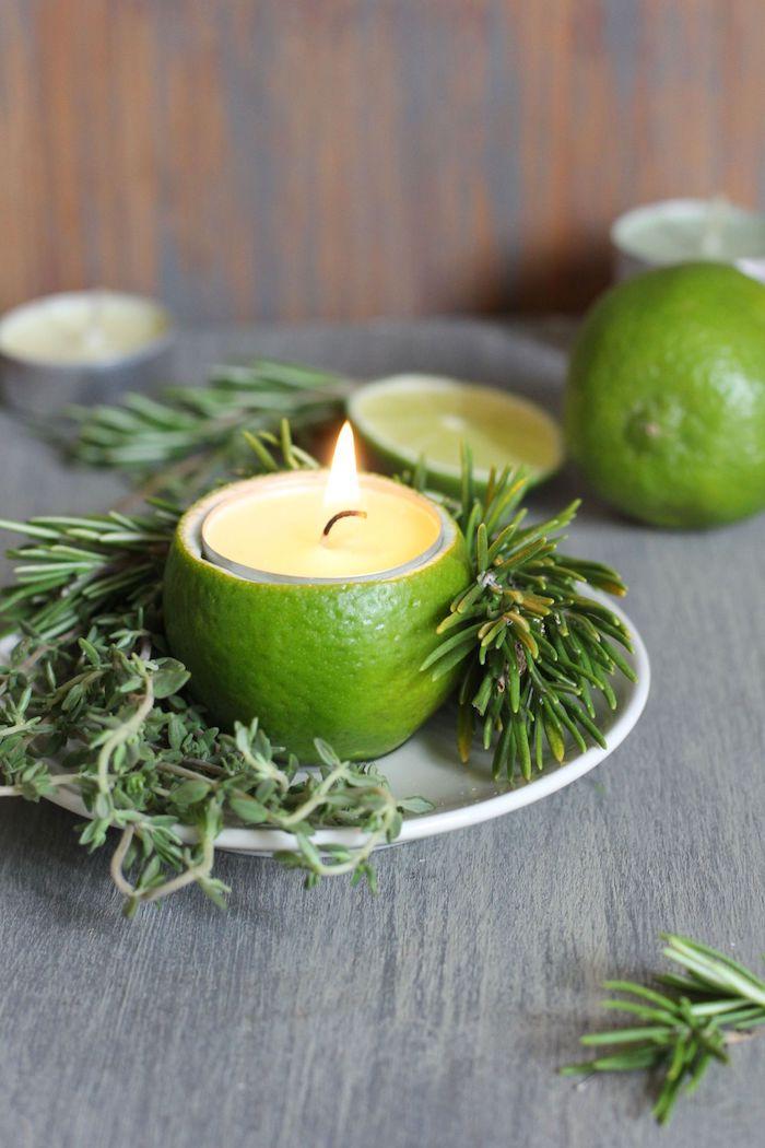 Kreative Idee für selbstgemachte Kerzenhalter, Kerzen in Limetten stecken