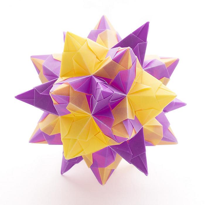 origami stern falten, ein großer bascetta stern falten mit gelben und violetten strahlen aus papier, basteln mit papier