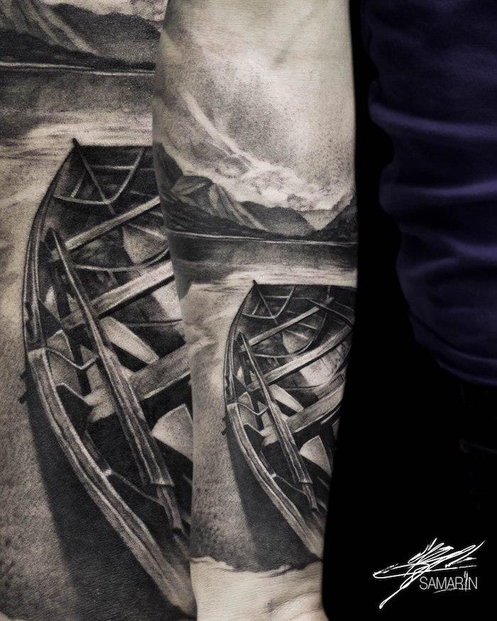 Tattoo am Unterarm, Boot See und Gebirge, Tattoos mit Bedeutung