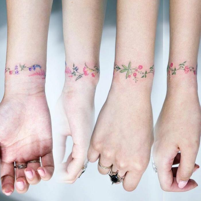 blumen tattoo arm, vier ärme mit tattoos in der gestaltung als armbänder, bunte tattoo ideen für beste freundinnen