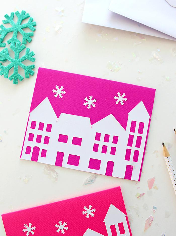 Weihnachtskarten mit Kindern basteln, rosa Grund, weiße Häuser und Schneeflocken