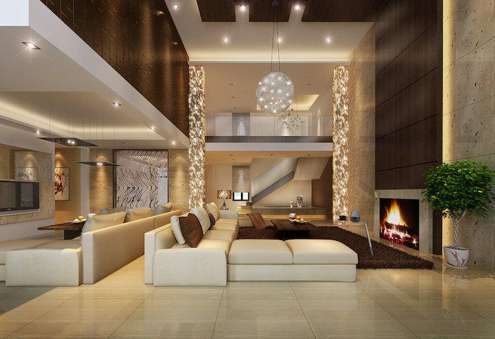 deko für wohnzimmer, runde pendelleuchte, beige keramikfliesen, großes weißes ecksofa, kamin