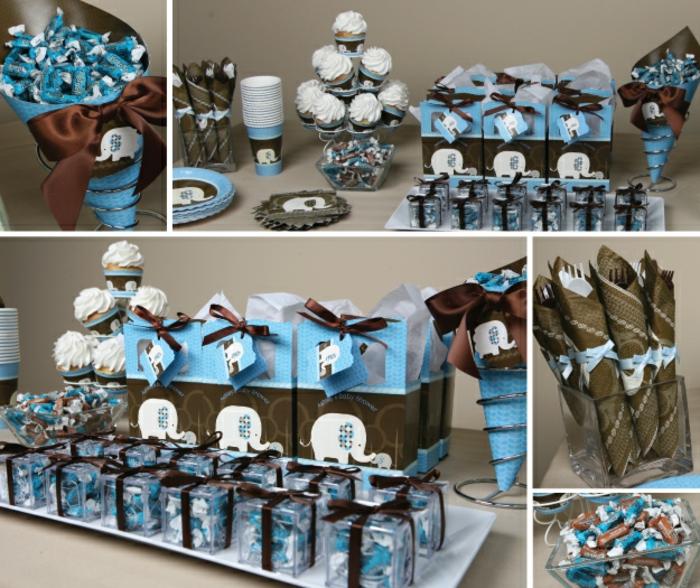 Babyparty Junge mit vielen Gastgeschenke und Cupcakes, Bonbons in einer Tüte