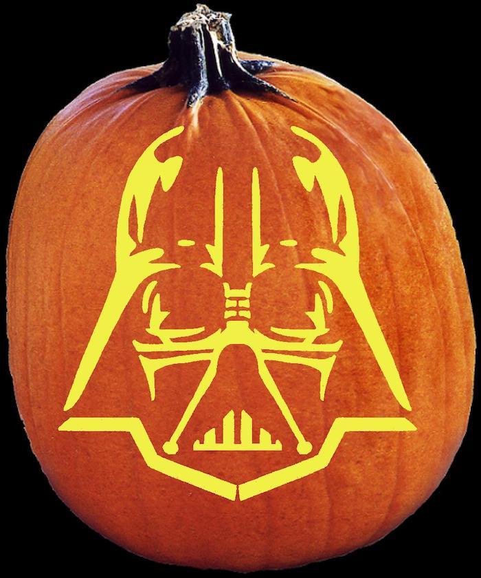 einen orangen halloween kürbis mit einem star wars motiv darth vader malen, kürbisgesicht malen ideen
