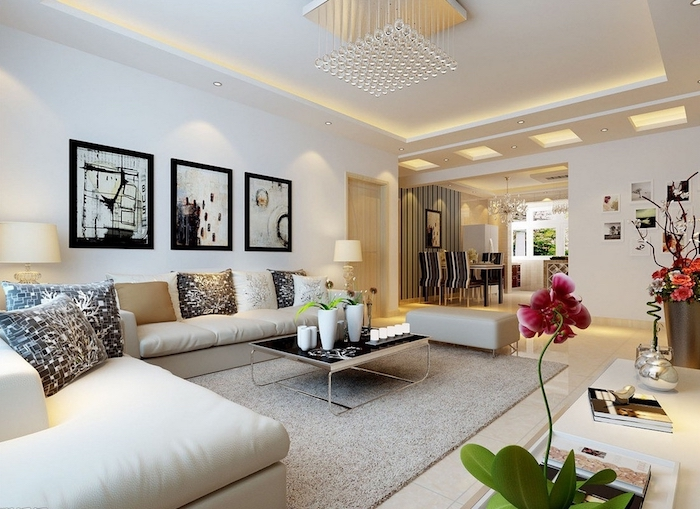 deko für wohnzimmer, drei bilder in schwarz und weiß, großes ecksofa, orchidee, weiße vasen
