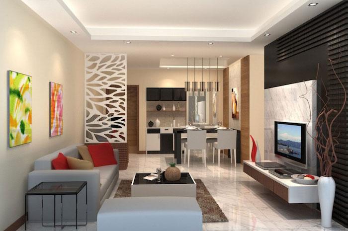 deko ideen wand, zwei abstrakte bilder in grellen farben, weiße trennwand, wohnzimmer und küche in einem