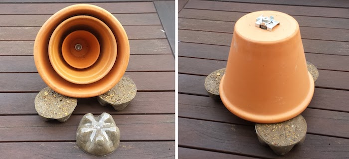 boden aus einem braunen holz und ein teelichtofen aus zwei braunen blumentöpfen aus keramik und mit sand, bastelideen für erwachsene, teelichtofen und schrauben