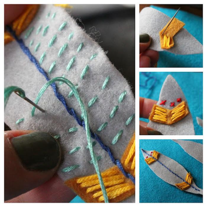 katzenspielzeug selber bauen, blatt aus grauem stoff dekoriert mit faden in verschiedenen farben