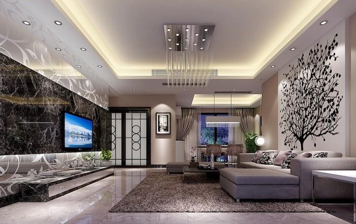 wohnzimmer einrichten, wandtattoo in der form von baum, fernsehwand, grauer teppich