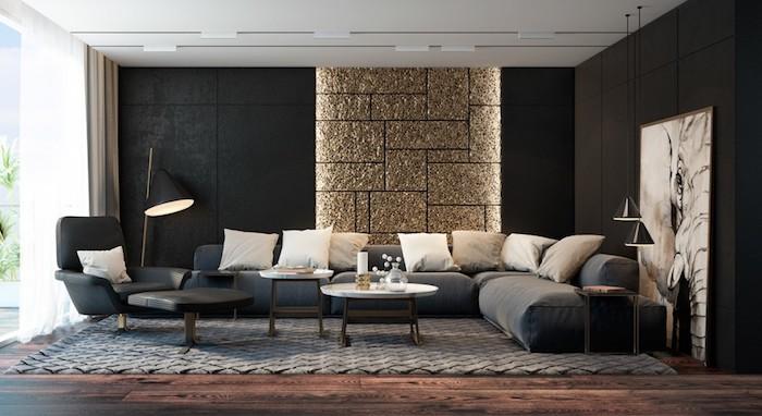 wohnzimmer ideen, schwarze wände, goldene 3d wand mit beleuchtung, großes bild in schwarz und grau