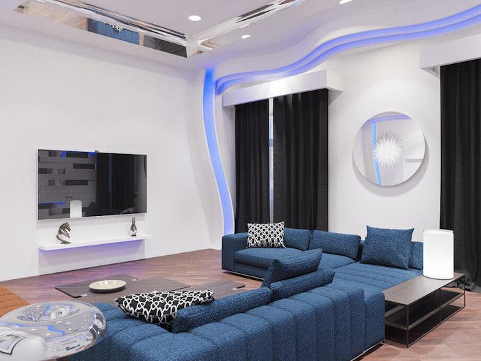 wohnzimmer ideen, blaues ecksofa mit dekokissen in schwarz und weiß, runder spiegel, wanddeko